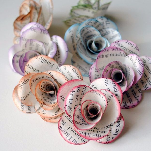Roses made out of old book pages with the edges painted pastel colors